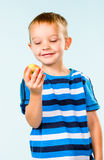 Boy and apple Royalty Free Stock Image