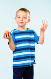 Boy and apple Royalty Free Stock Photography