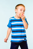 Boy and apple Stock Image