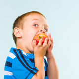Boy and apple Royalty Free Stock Images