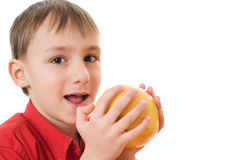 Boy is the apple and opens her mouth Stock Photos