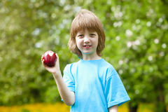 Boy with Apple Showing Heart Shaped Bite Off Royalty Free Stock Photography