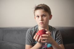 Boy with apple. Teenage caucasian boy with red apple. Portrait at home Stock Image