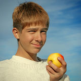 Boy and Apple Stock Images