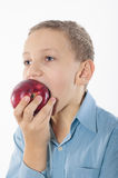 Boy with an apple. On a white background Stock Images