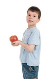 Boy with apple on white royalty free stock photos
