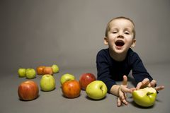 Boy with apples. Portrait of a cute boy with apples Stock Image