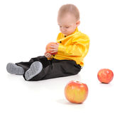 The boy and apples Royalty Free Stock Photography