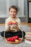 Boy with apples and books  at home Royalty Free Stock Image