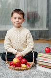 Boy with apples and books  at home Royalty Free Stock Photo