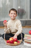 Boy with apples and books  at home Stock Photo