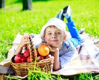 Boy with apples outdoor Stock Photo