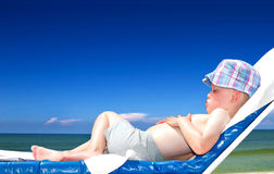 boy applying sun tan lotion Royalty Free Stock Photos