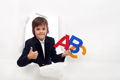 Boy approves the opening of back to school season Royalty Free Stock Photo
