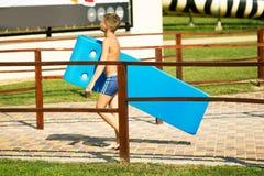 Boy in aqua park Stock Images