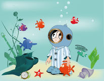 The boy in an aqualung. The sea and small fishes Royalty Free Stock Photos