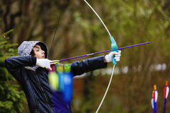 Boy archer shooting with his bow at an outdoor Royalty Free Stock Image