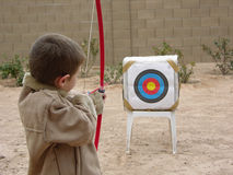Boy Archer Three. Boy shooting arrow at target Stock Photos
