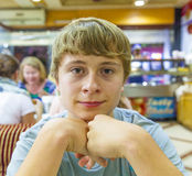 Boy in arestauant waits for Stock Images