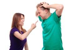 Boy arguing with his girlfriend. Studio shoot stock photo