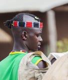 Boy from Ari tribe at village market. Bonata. Omo Valley. Ethiop Stock Image