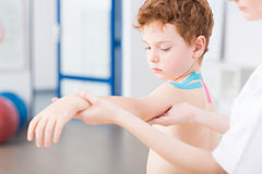 Boy and arm problems after injury Stock Photos
