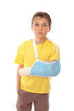 Boy in arm sling. Hurt boy with one arm in a sling and a scrape over right eye stock photos