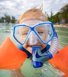 Boy with armbands, mask and snorkel Royalty Free Stock Photos