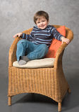 Boy in the armchair Stock Photos