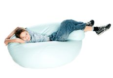 Boy on armchair. Smiling Boy on armchair over white background Stock Photos
