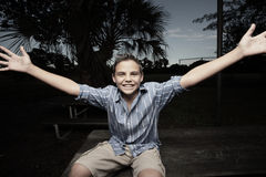Boy with arms extended Royalty Free Stock Image