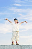 Boy with arms outstretched Royalty Free Stock Photo