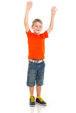 Boy arms up. Excited little boy with arms up on white background Royalty Free Stock Images