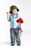 Boy with army helmet and carnations, isolated on w Stock Images