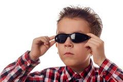Boy arranging sunglasses Royalty Free Stock Photo