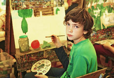 Boy in art school has paiting lesson stock photo