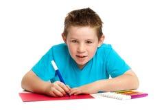 Boy Artist. Doing artwork with felt pens. Studio white background Stock Photography