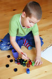 Boy artist. Boy is taking painting colors with a brush Stock Photo