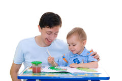Boy-artist with father Royalty Free Stock Photos