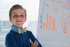 Boy as business executive presenting on white board Royalty Free Stock Images