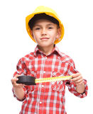 Boy as a construction worker with tape measure Stock Photo