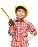 Boy as a construction worker with tape measure. Happy cute boy as a construction worker with tape measure, isolated over white stock photos