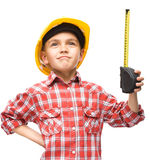 Boy as a construction worker with tape measure Royalty Free Stock Image