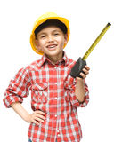 Boy as a construction worker with tape measure Stock Images