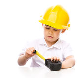 Boy as a construction worker with tape measure Stock Image