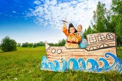 Boy as pirate and princess girl stand on ship Stock Photo