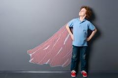 Boy as a super hero stock photos