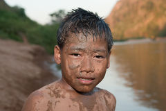 Boy of Asia with sand in the face Royalty Free Stock Photo
