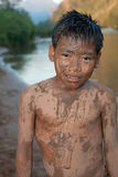 Boy of Asia with sand in the face Royalty Free Stock Photos