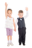 Boy and Asian girl with their hands raised in greeting Royalty Free Stock Image